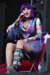 British singer Jessie J performs on stage with a broken leg Saturday, Aug. 20, 2011 at V Music Festival in Hylands Park, Chelmsford, England.  If any performer had an exuse to not wear pantyhose on stage, it would be Jessie for this event, but she had the class and professionalism to wear even with that therapeutic boot.