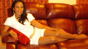 Juanita relaxes lounges in her home in London, wearing Act II Suntan.
