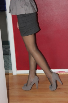 Yesenia heads off to the job in a professional outfit, complete with Act II Off Black pantyhose.