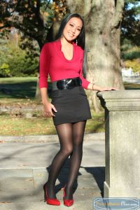 At work in a hot nightspot, or on her college campus, Mylani always looks her best in a skirt, heels and pantyhose.