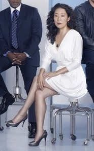 The few times Korean actress Sandra Oh wears an elegant outfit with sheer pantyhose, she is among the most beautiful Asian stars.