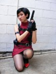 A model beautifully cosplays Ada Wong in a costume featuring some delicious-looking pantyhose.