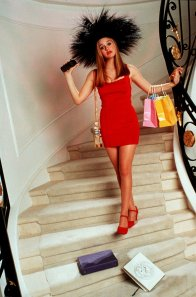 "Alicia Silverstone as Cher prepares to go out on the town in a scene from ""Clueless."""