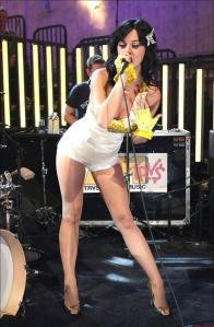 Katy Perry always puts on a high-energy show, and always dresses beautifully in sheer pantyhose.