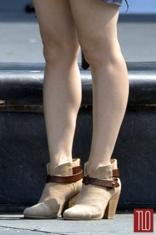 "Lucy Liu's bare legs on the set of ""Elementary"" last month in New York."