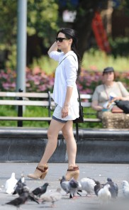 "Lucy Liu bare-legged during a scene from ""Elementary"" in New York."