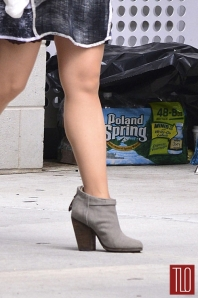 Lucy Liu's pantyhose-graced legs on the set of