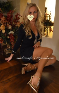 For a client, Madam Sofie wears a beautiful dress and high heel sandals, complete with Act III Nude pantyhose.