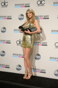 Singer Taylor Swift wins Artist of the Year, Favorite Pop/Rock Female Artist, Favorite Country Female Artist, and Favorite Country Album awards during the 2013 American Music Awards Sunday in Los Angeles, Calif.