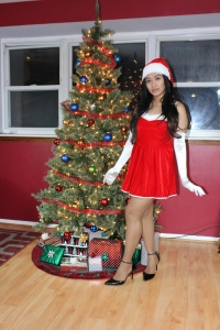 Leilani dons Christmas outfit complete with Act IV Suntan.
