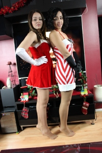 Olivia, left, and sister Ariel prepare Christmas decorations, wearing Act IV suntan.