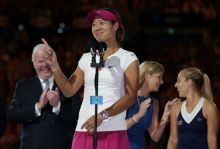 2014 Australian Open winner Li Na jokes with the crowd during her acceptance speech Jan. 25, 2014 in Melbourne, Australia.