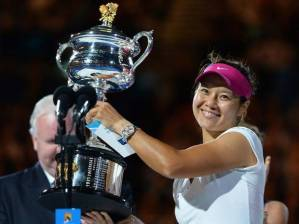 Li Na displays the 2014 Australian Open trophy for women's singles final championship.
