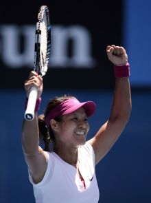 Li Na celebrates on court after winning the 2014 Australian Open.