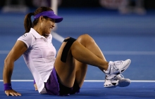 Li Na grimaces in pain after spraining her ankle during the second set of the 2013 Australian Open women's singles championship match.