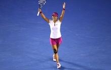 Li Na celebrates her victory on court after winning the 2014 Australian Open women's singles championship Jan. 25, 2014 in Melbourne, Australia.