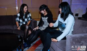Li Na, left, jokes with friend and fellow WTA tennis pro Zheng Jie and an unidentified woman about the marks on Li's knee from the physio tape she wears during play.  The chat was during a dinner ceremony for the Shenzhen Open tournament held from Dec. 29 to Jan. 4, 2014 in China. (Li won the title.)