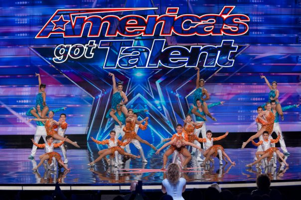A high-energy Colombian (I think) dance team auditions during Season 9 of America's Got Talent, wearing beautiful and exotic costumes, complete with sheer suntan pantyhose.