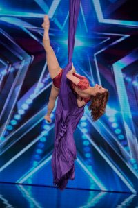 An aerialist performs during AGT Season 9.