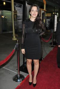 Sarah Shahi typically wears a black dress and heels, with her usual bare legs as the character, Samina Shah, on the CBS drama,