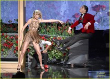 Usually more classy, Taylor Swift inexplicably goes bare-legged in an elegant evening gown, which gave way to a sexy little number even for a formal set on stage at the AMAs.