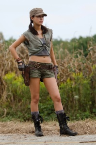 "Christian Serratos (Rosita Espinoza on ""The Walking Dead"") plays a feminine but capable survivor of the zombie apocalyse."