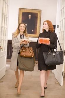 Actresses Sarah Jessica Parker, left, and Christina Hendricks on the way to a meeting in the movie,