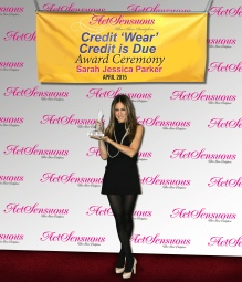 Actress Sarah Jessica Parker shows off her Act Sensuous Credit 'wear' Credit is Due award last month in Indialantic, Fla.