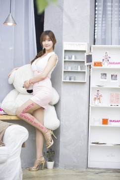 Unidentified Korean professional model has a leg up on her bear