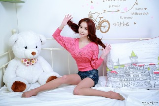 Korean professional model Jung Jung Ah plays with her bear