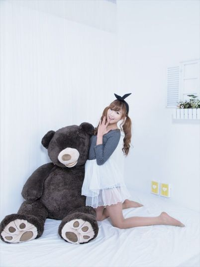 Korean Professional model Lee Eun Hye cozies up to a bear