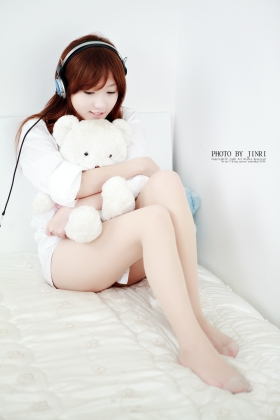 Korean professional model So Yeon Yang hugs her bear