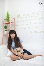 Korean professional model Lee Eun Hye holds her bear closely