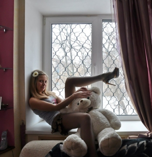 Unidentified young lady wearing pantyhose teases bear