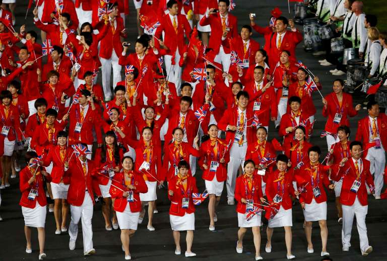 Members of China's contingent wave as they take part in the athletes parade during the opening ceremony of the London 2012 Olympic Games at the Olympic Stadium