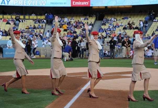 Members of the United Emirates cabin crew take the field earlier this year for a special presentation at the Los Angeles Dodgers baseball stadium.