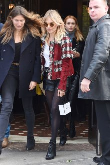 British-American actress, Sienna Miller, wears a plaid tweed jacket with shorts and peep-toe booties.