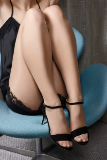 Unidentified lady wearing pantyhose (quite beautifully) with high-heel dress sandals .